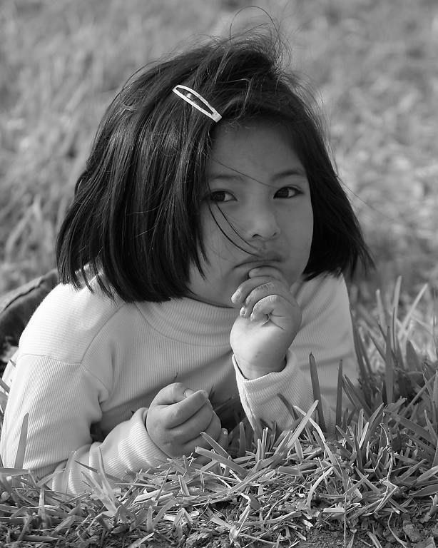 Girl in grass Peru