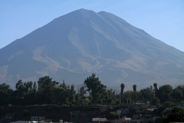 Early morning light from Arequipa city, over the bank of the Rio Chile - up to the active Volcan Misti, rising to about 19,100 ft. (5,822 m) in the Cordillera Volcanica, along the Cordillera Occidental Andes - Arequipa department.