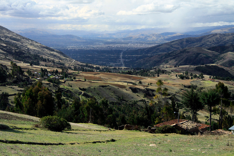 From the cultivated slopes in the Sapallanga district, along ruta 113, viewing northwest into the Mantaro Valley - and the city of Huancayo among the sunlight and cloud shadow - Junin department - western edge of the Cordillera Central Andes.
