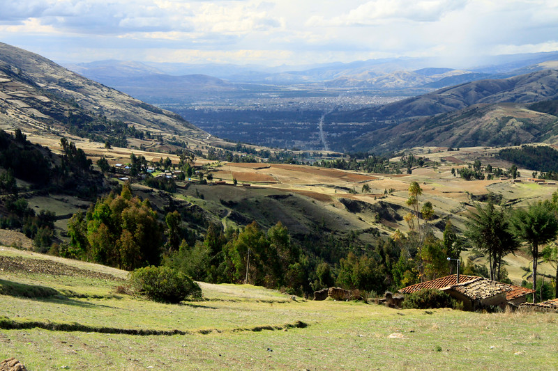 Northwest view from the cultivated slopes of the Andean Mountains, at about 11,800 ft. (3,600 m), near the southern border of the Junin department - down into the Mantaro Valley and the city of Huancayo.