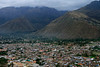 Beyond Urubamba town - to the slope and peak of Cerro Corralmojo in the clouds (l) and the slope of Cerro Jahuayquilla (r), between is the Quebrada Jonayhuayo - Cusco department.