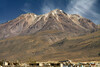 Dwellings along the southern lower slope of Volcan Chachani - up to the summit (l), which is the highest point in the Arequipa department, rising to about 19, 872 ft. (6,057 m) - with the cirrus clouds above - central Arequipa province - Arequipa department.
