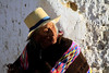 Elder Quechua woman peering into the early morning sunlight of the early spring season - at the mountain village of San Pedro de Casta - Huarochiri province - Lima department.