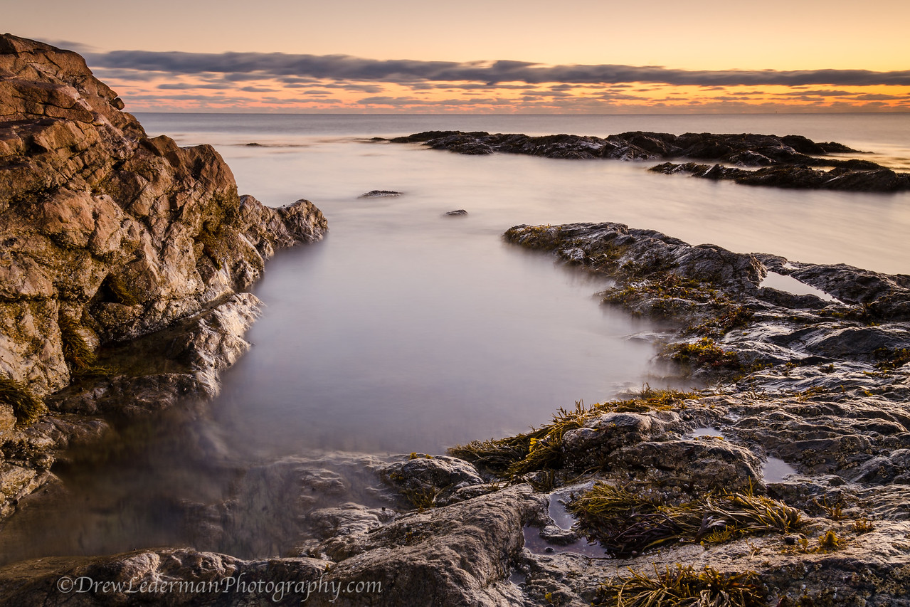 11/9/13<br /> Brant Rock. Marshfield, MA<br /> <br /> Here is the other shot that I liked from the sunrise shoot at Brant Rock the other morning. A 20 second exposure to mist the water a little bit and give the picture a mystical feel. I really enjoy the contrast of the soft water against the hard texture of the rocks to the right. Good golden light as the sun just broke over the horizon in the east with a nice set of clouds rolling in from the north to keep the sky from being boring.