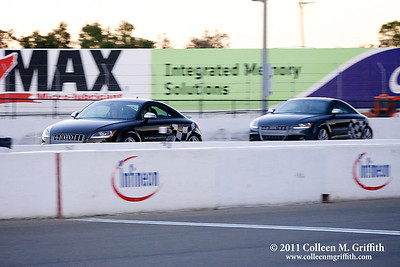 Kevin and Tim (crisp car) passing Jim and Rob (blurry car) © 2011 Colleen M. Griffith. All Rights Reserved.  This material may not be published, broadcast, rewritten, or modified in any way without permission. www.colleenmgriffith.com www.facebook.com/colleen.griffith  Audi Sportscar Experience, Infineon Raceway in Sonoma California