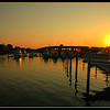 Shot while waiting to go Blues Fishing in Belmar NJ. I had just turned into the parking lot and got stuck waiting for a guy to launch his boat when I saw the sun coming up over the new Rt. 35 bridge. I waited for a few minutes until it cleared the bridge and stated firing away. I love the orange glow it cast off the water and the slight lens flair I was able to capture even though I had my circular polarizer mounted. Without it I wouldn't have managed this shot as the sun was too powerful and would have flooded the sensor and caused the shot to be over exposed.