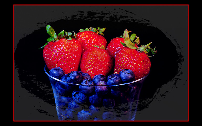 Last night was food shopping time so I found these in the fridge today. There not the quality I would use for a food ad but I did with what I had. They were shot using a single over head light slightly forward and then processed using a blue graduated filter over the blueberries to darken then to bring attention to the strawberries. A simple frame in & slightly wider out was applied for the finish.<br /> Shot with Tripod mounted Tamron 90mm Di f/2.8 macro using settings of:<br /> Shutter: 1/4 sec.<br /> AP: f/36<br /> ISO 1000<br /> WB: Cool White Fluorescent