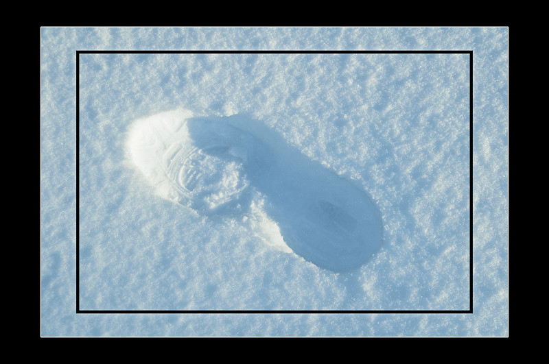 """Foot of Snow"" A shot of my foot print in the recent snow we got, I really liked the 1/2 shadow 1/2 lit result of the capture"