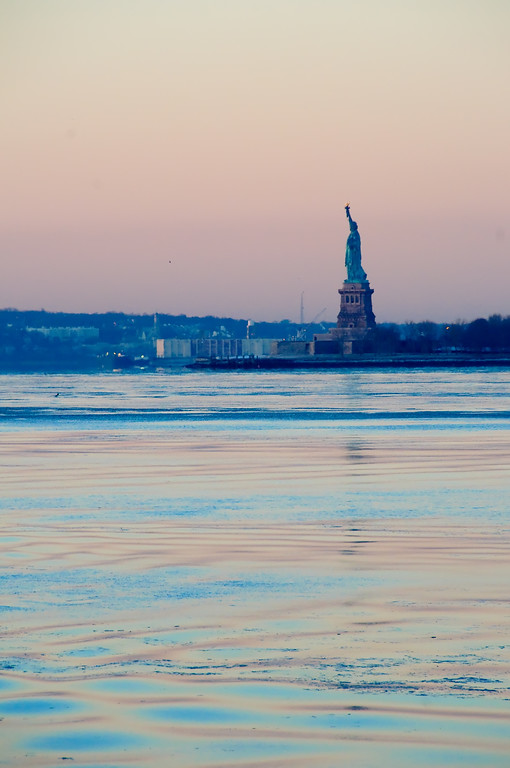 Added 1/20/09<br /> <br /> The Statue of Liberty captured from Battery Park NY during sunrise
