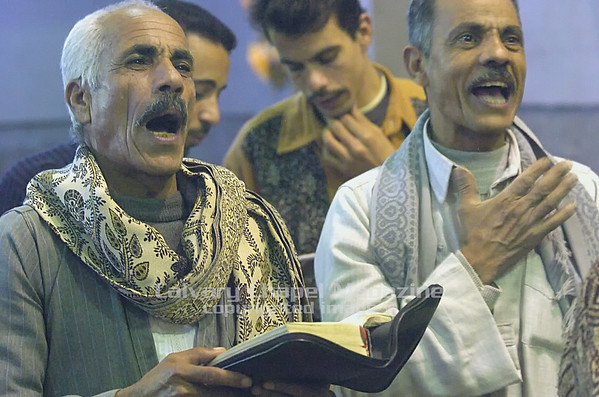 Grace Church, Cairo Egypt - Men at Grace church in Cairo, Egypt  sing at a worship service.