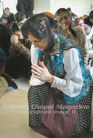 Elderly women in Romania pray.