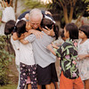 Pastor Joe Rosmarino returns home from the Philippines Pastor's conference and is greeted by many of the children of the orphanage.