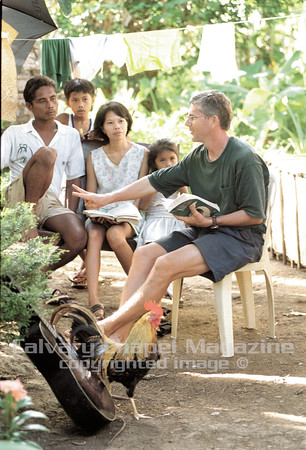Jerry and Maritess listen to missionary Dave Matthews teach the Bible study in Sagurong, Philippines