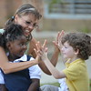 Olga Price of Calvary Chapel Fredericksburg VA, plays with children at the boys and girls club in Bay St Louis, MS.