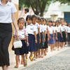 Girls walk across the courtyard at a Christian school in Cambodia. Despite some of their troubled backgrounds, the student's joy of attending the school has led many locals to the church to learn about Jesus.
