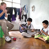 Travis plays his harmonica with two blind boys in a dorm room at the Yangon Education Center For the Blind in Yangon, Myanmar.