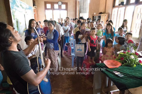 "Sunday morning worship services are held on the outskirts of Lashio at a ""home church"" inside a villager's home."