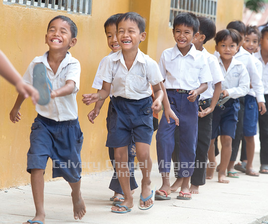 Second grade boys head to morning worship after their flag raising ceremony. Despite some of their troubled backgrounds, the student's joy of attending the school has led many locals to the church to learn about Jesus.