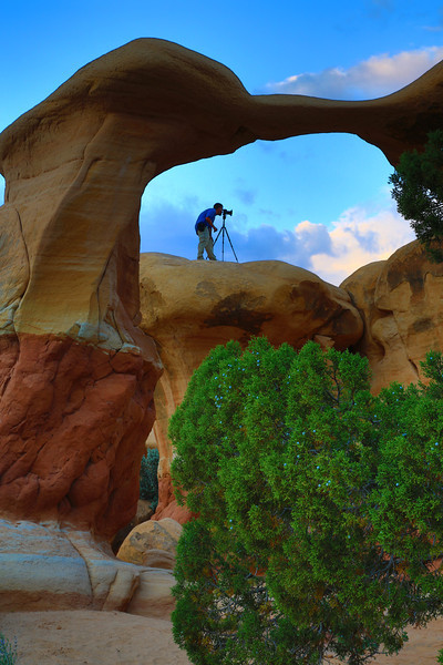 Photographer and Metate Natural Arch in Devils Garden Escalante National Monument Utah
