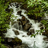 """A waterfall on the """"Trail of Time"""" hiking trail at Mendenhall Glacier."""