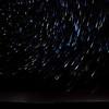 Star trails on a dark night.