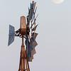 Detail of a windmill and full moon. Saskatchewan