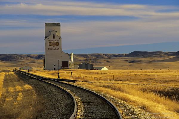 Grain elevator and train tracks at sunset, Rockglen