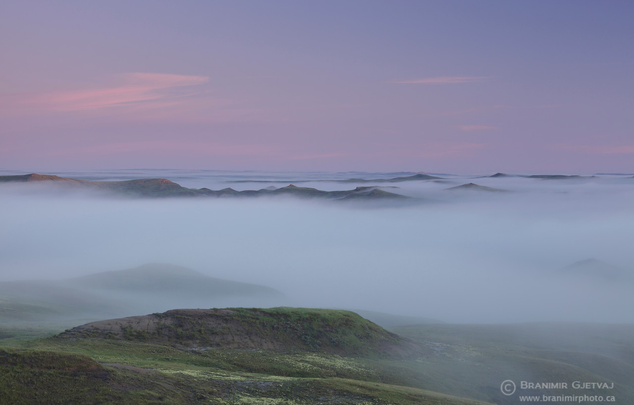 Dense morning fog in the East Block badlands. Grasslands National Park, Saskatchewan