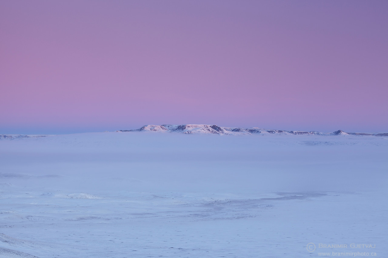 Colourful sunrise over Frenchman River Valley and 70 Mile Butte, Grasslands National Park