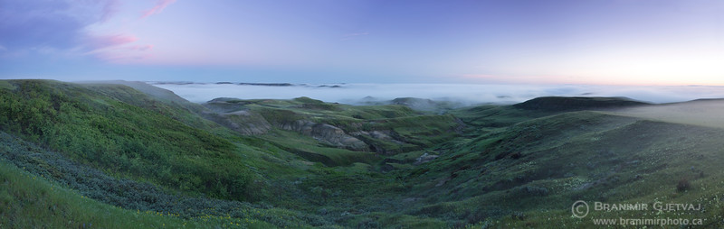 Morning fog in Grasslands National Park badlands.
