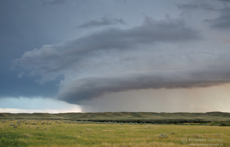 Dramatic storm cloud passing through Grasslands National Park, Saskatchewan