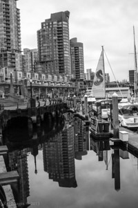 City reflected in Coal Harbour.