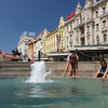 Children play around Manduševac water fountain on Jelačić Square in Zagreb, Croatia