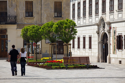 Couple walking in historic downtown Varazdin, Croatia