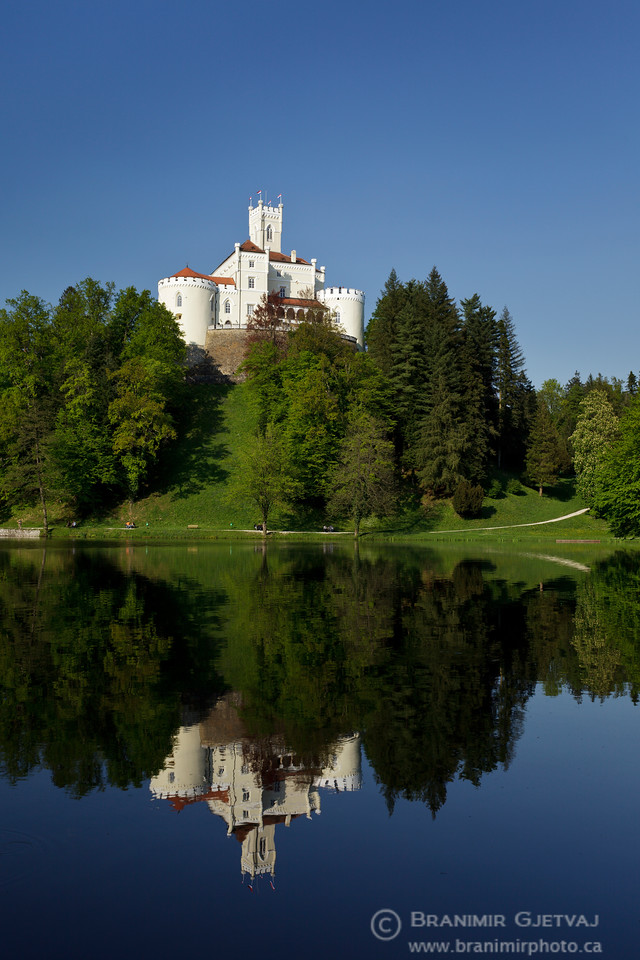 View of Trakoscan castle reflecting in lake, Croatia