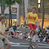Unicycleists Ride in the Salute to Youth Parade in Waikiki