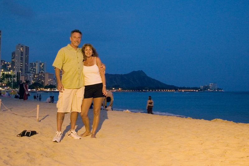 A Couple Poses on the Beach for a Memorable Picture.