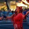 A Woman Prepares to Eat Fire at the Salute to Youth Parade in Waikiki