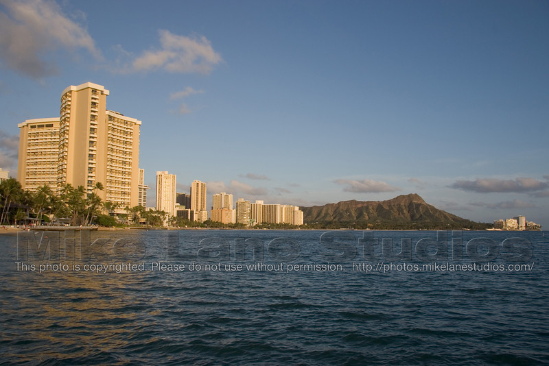 Waikiki beach hotels and diamondhead at sunset