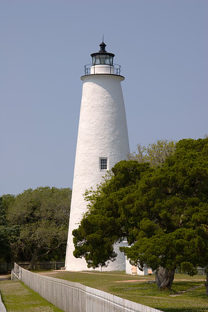 Ocracoke Lighthouse - Trees and fence in foreground