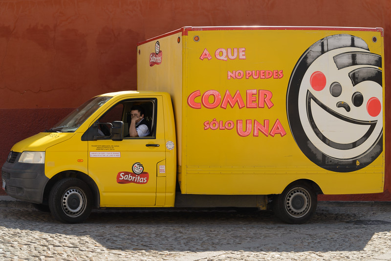 The driver is wondering if we cannot eat just one.  Shot somewhere on the streets of San Miguel de Allende.