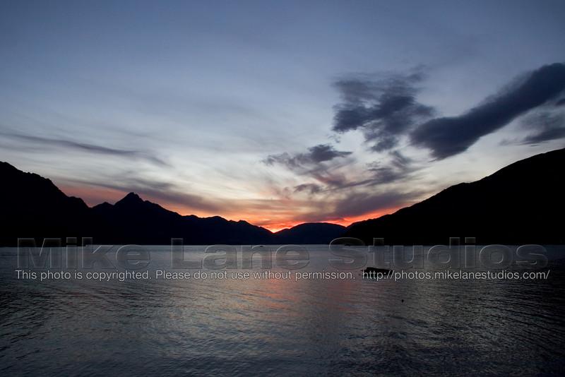 The sun sets over Lake Wakatipu New Zealand.