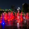 The fountain off Riverside overlooking Austin skyline at night