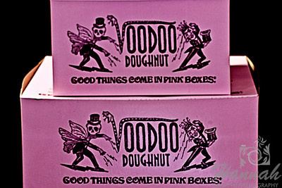 Pink doughnut boxes from Voodoo Doughnut... a famous doughnut shop located in Portland, Oregon which is known for its unusual doughnuts and the eclectic decor of the shops.   Shot with the Lensbaby composer with edge 80 optic  © Copyright Hannah Pastrana Prieto