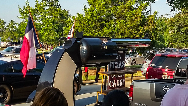 Only in Texas...A BBQ cooker shaped like a gun being driven up and down the street at a Trump Rally.