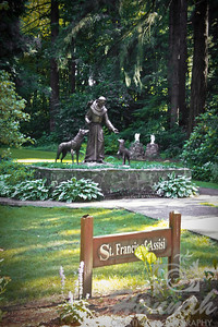 "From the distant you can see the statue of St. Francis of Assisi at the botanical gardens of ""The Grotto"" in Portland, Oregon  © Copyright Hannah Pastrana Prieto"