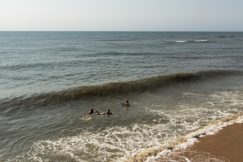 These surfers are surfing to the right of the Avon Pier!