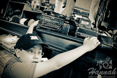 Boy curious and touching an antique typewriter and adding machine found at a store in Vancouver, British Columbia, Canada   © Copyright Hannah Pastrana Prieto