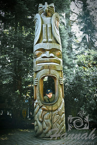 Boy Behind the Totem Poles at the Capilano Suspension Bridge Vancouver, British Columbia, Canada   © Copyright Hannah Pastrana Prieto
