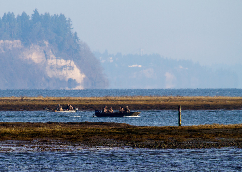 Hunters of ducks- looking into the Puget Sound.